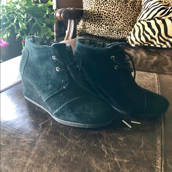 f7043d6c158 TOMS Kala Suede Lace Up Wedge Booties. M 5bc2541a534ef9a979a86aae